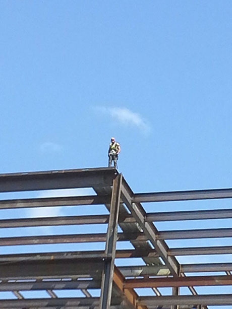 Ironworker Eric Brugeman on top of a structure