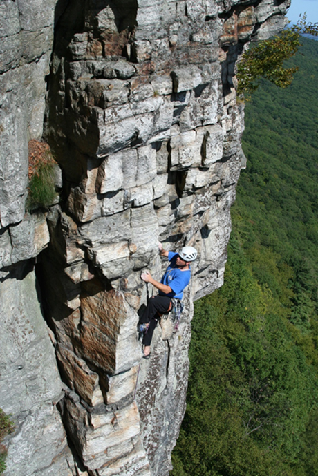 Doug Ferguson on the side of a mountain rock climbing