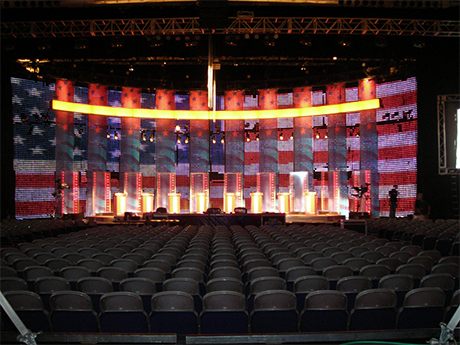 The stage at the Republican and Democratic National Convention with a giant lite up American flag